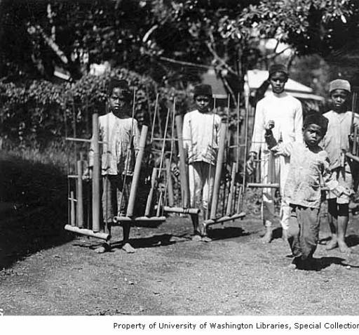Wright's Photo: Group of boys with bamboo instruments called angklung, Java, ca. 1921 (University of Washington Libraries).
