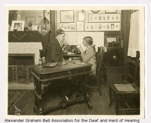 Wright examining a child (Alexander Graham Bell Association for the Hard and Hearing Collection; Disability History Museum)