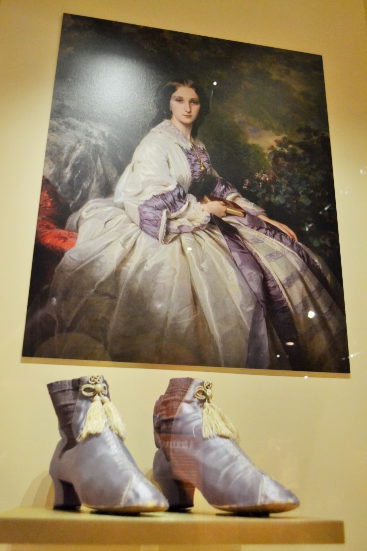 """Perkins purple,"" the first synthetic dye, was discovered by British chemist William Henry Perkins by accident. Perkins was trying to find a cure for malaria. By 1858, this new ""mauve"" color became incredibly popular as it spread throughout the fashionably minded.  Shoes: French, c.1860 (Collection of the Bata Shoe Museum)"