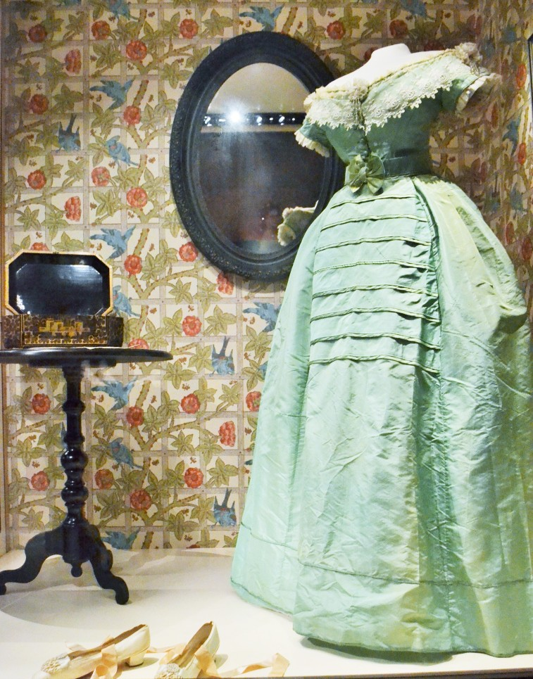 "Chemist Carl Scheele invented the first colorfast green dye in 1778 by combining poisonous arsenic with copper. Cheap and beautiful green dyes became very popular throughout the nineteenth century and were used for all sorts of things: interior decoration, fabrics, shoes, wallpapers, and even children's toys. This ""Emerald Green"" ball dress was chemically tested and contains arsenic. Dress: c.1860-1863 (Collection of Glennis Murphy) Shoes: European, 1860s (Collection of the Bata Shoe Museum)"