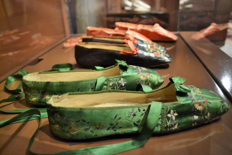 Narrow shoes were popular fashion as they reflected cultural ideals about female delicacy and domesticity. They were also painful, as they negated the natural architecture of the foot, causing extreme pain for the wearer.   Shoes, c.1840s (Collection of the Bata Shoe Museum)