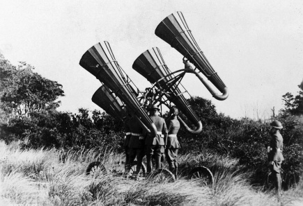 American troops during World War I using an acoustic locator, mounted on a wheeled platform to monitor distant sounds (U.S. National Archives).